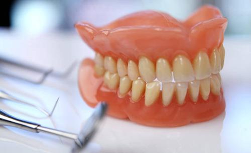коррекция зубных протезов