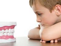 болит молочный зуб